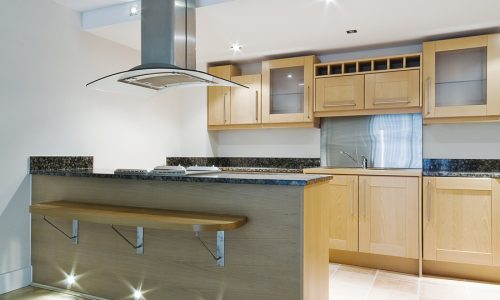 modern kitchen isle with breakfast bar and designer elements